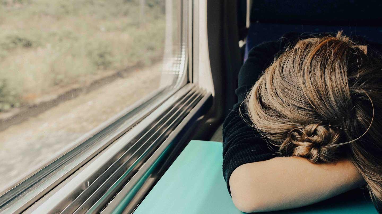 Girl asleep on a train