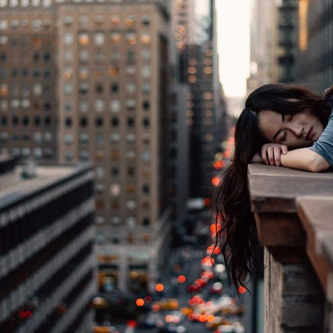 girl fell asleep on city balcony