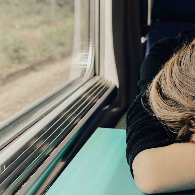 Girl asleep on a train